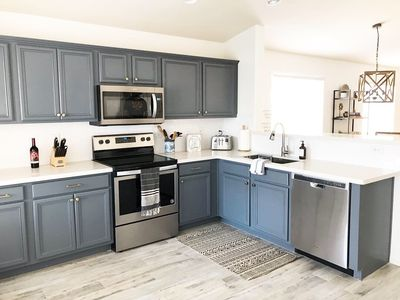 Remodeled kitchen with quartz countertops and brand new appliances