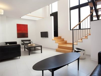 Photo for Modern and spacious three bedroom apartment with patio, in the Park Guell area of Barcelona, that ca