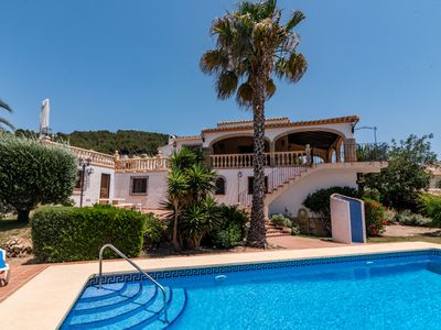 Photo for This 6-bedroom villa for up to 12 guests is located in Javea and has a private swimming pool, air-co
