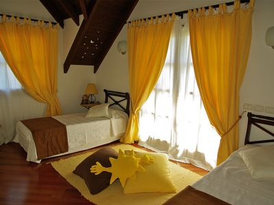 Yellow Double Bedroom with balcony and air condition. Beds wide 90 cm.