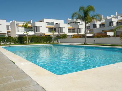 Photo for modern new apartment, two large seaview-terraces, sunloungers, large common pool, own parking, only 400m to the beach, for 4 persons, with Wifi and aircon