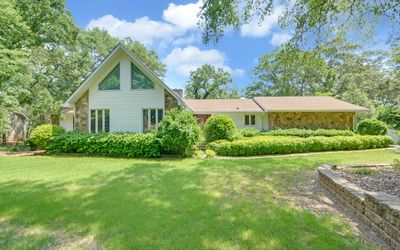 Beautiful front yard long tree lined driveway with a fenced yard