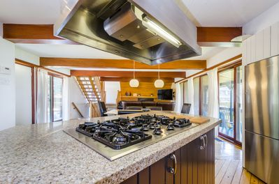 Cooktop and island make this a highly functional kitchen.