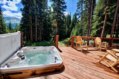 The hot tub & large back deck is a great place to hang out.