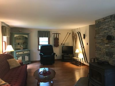 Spacious living room to watch TV and keep warm by the wood burning stove