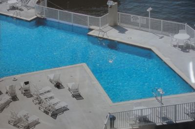 Plenty of space to lounge and swim at the outdoor pool with infinity waterfall.