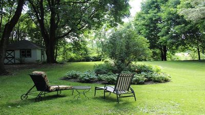 Lounge in the flower GARDEN with lovely old trees