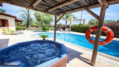 Photo for Spacious Villa, Large Private Pool, Outdoor Jacuzzi, Attractive Gardens, 10 min walk to the Beach!