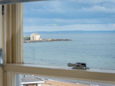 Photo for Large, stylish, airy 3 bedroom apartment on beach with free wifi and parking
