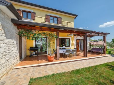 Photo for Detached house with fenced garden and frame pool near Porec and the beach