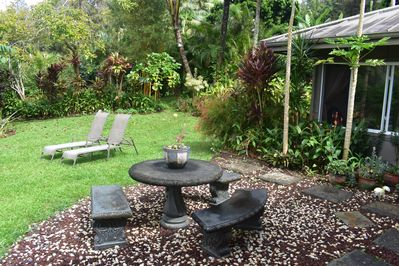 Relax with the lush tropical prana in the inner courtyard