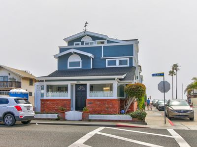 Photo for Spacious home with A/C - just steps from the beach w/ a deck & full kitchen