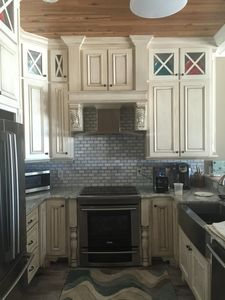 Custom cabinets with new stainless steel Electrolux appliances.