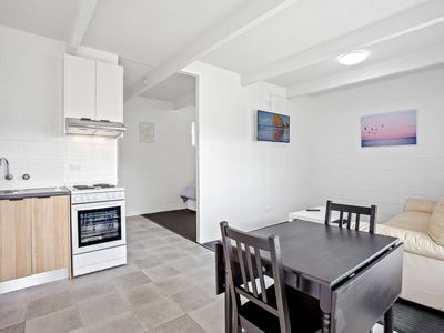 Photo for Self-contained studio apartment in the middle of town!