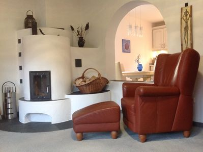 Lovely stove/fireplace and comfortable chair to relax