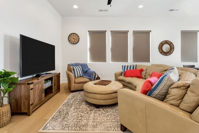 Family room featuring comfortable sectional seating and a large flat screen tv