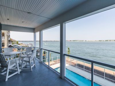 Photo for Spacious bayfront condo w/ balcony, shared pool - a few blocks from the beach