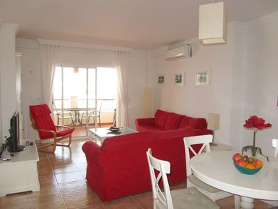 Part of living with dining corner and view to the terrace