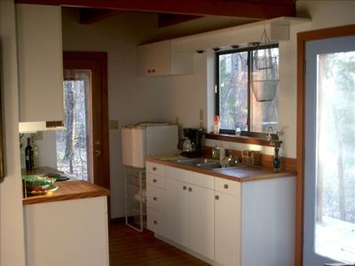 This small kitchen has every thing needed for enjoying a meal.