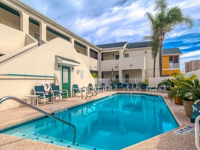 Photo for Island condo w/ balcony, shared pool, & hot tub - one block from the beach!