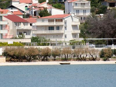 Photo for Two bedroom apartment with balcony and sea view Marina, Trogir (A-5968-a)