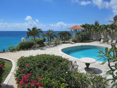 Pool and ocean view from balcony