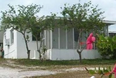 Your cottage with screened in porch overlooking the ocean & Moriah Harbour Cay