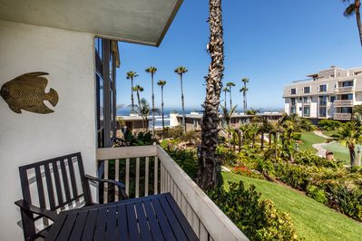 Balcony View - Lovely views of the ocean and the gorgeous tropical grounds are yours to enjoy!