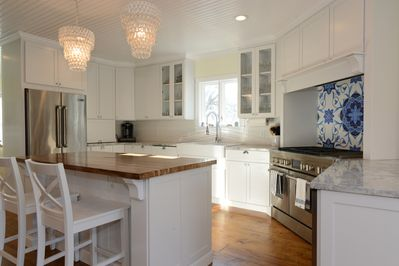 Gourmet kitchen with double oven and six burners