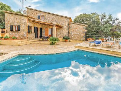Photo for 2 bed villa near town w/ triangular pool, covered terrace, BBQ + free Wi-Fi inc Smart TV.