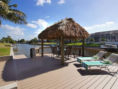 Photo for Elegant villa, electrically heated pool, south along the canal, Tiki Hut dock, canoe