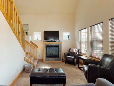 Photo for Conveniently located all-seasons cottage w/ fireplace & screened porch!