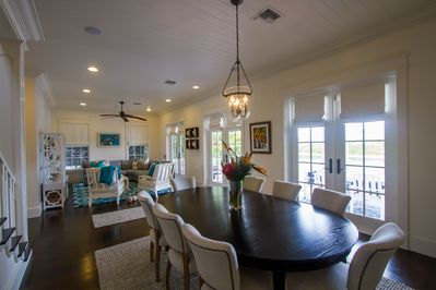 The dining room and living room with doors to back patio
