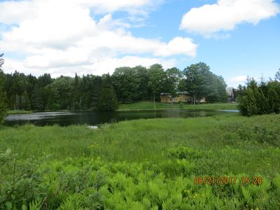 Another view of pond and house.