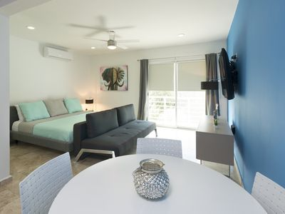 Photo for Comfortable suite located just meters from the beach