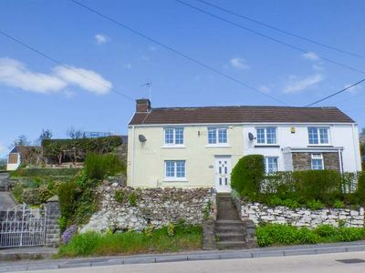 Photo for DRIFTERS COTTAGE, pet friendly, with a garden in Pembrey, Ref 938173
