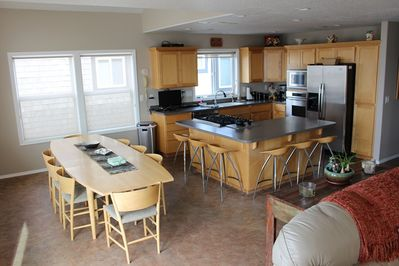 Fully equipped kitchen with gas stove top.  Seating for 14.