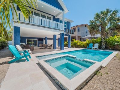 Photo for SIGN OF THE MERMAID- beautiful home, steps to the beach, private pool