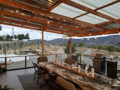 huge covered deck with market lights and bluetooth built in home theater system