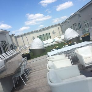 roof top resident sun lounge with cabana loungers, comfy seating, and grilling