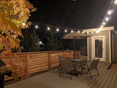 Backyard with deck and lights