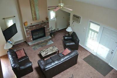 Spacious Living Room on First Floor.  Comfortable leather furniture and large TV
