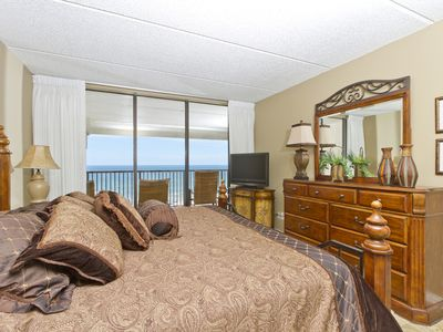 Master bedroom with a beach view