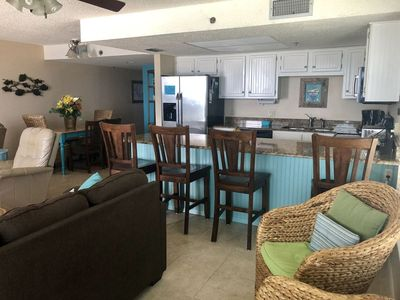 Dining Table seats six and large kitchen bar seats four