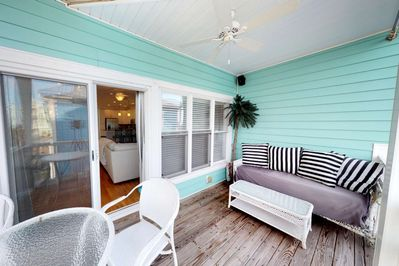 Catch a glimpse of the ocean or have a cocktail on the roomy deck right off the main living space.