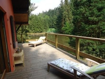 Photo for Chalet in the middle of nature, with a pond