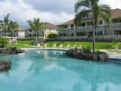 Beautiful lagoon style pool. Our 2nd story condo is behind man with arms raised