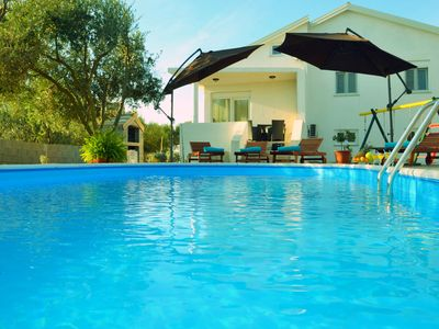 Photo for This 3-bedroom villa for up to 8 guests is located in Privlaka and has a private swimming pool, air-