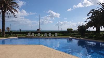 Photo for Cozy Beach Apartment with pool, by the Sea in Estoril