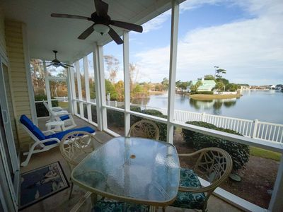 Photo for Perfect lake view.  Gated community. 3 bedroom, 2 bath condo sleeps 8. Great amenities! Walk to beach!